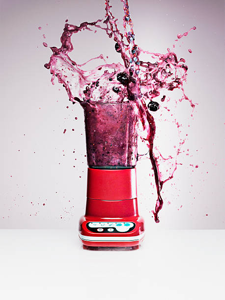 Blueberry juice splashing from blender  blender stock pictures, royalty-free photos & images