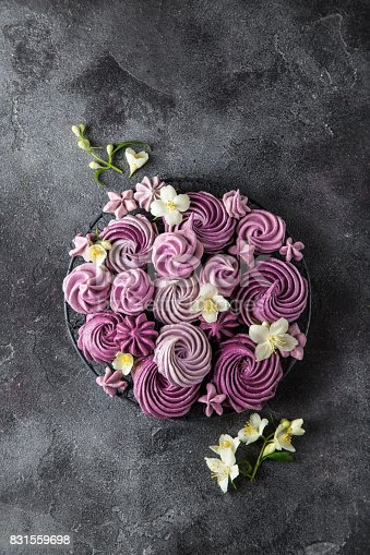 istock blueberry meringues on dark grey  background 831559698