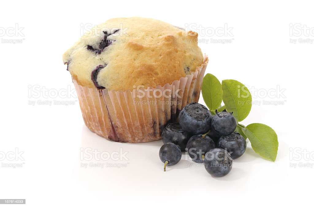 Blueberry Muffin and fresh blueberries, isolated on white stock photo