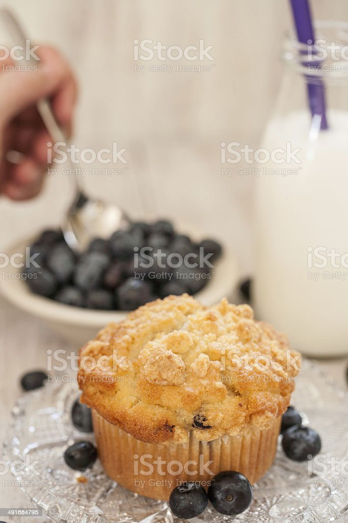 Blueberry Muffin Breakfast With Hand Spooning Blueberries stock photo