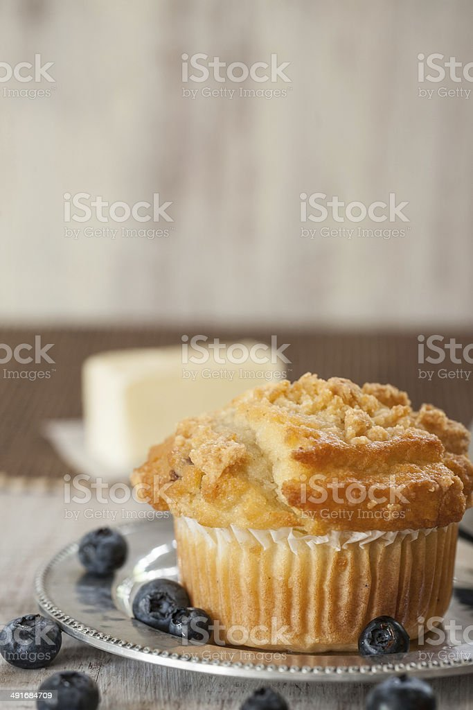 Blueberry Muffin with Blueberries and Butter in Background stock photo