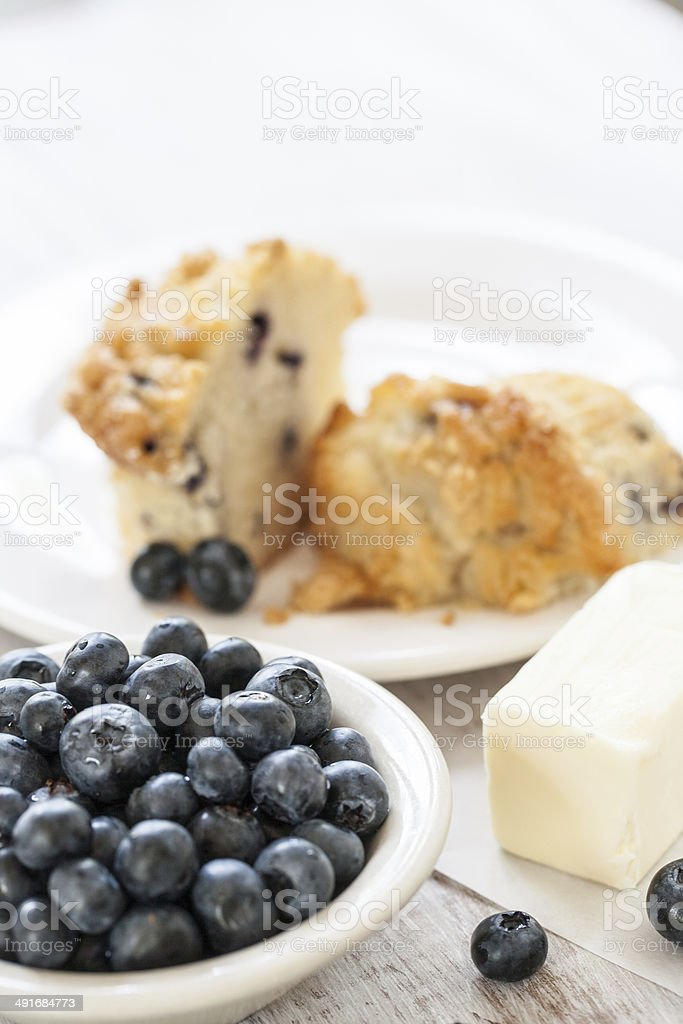 Blueberry Muffin With Butter and Bowl of Blueberries stock photo