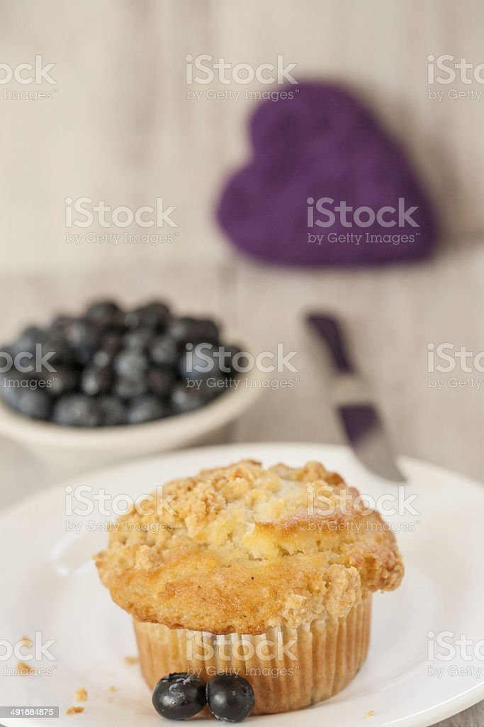 Blueberry Muffin With Knife and Heart in Background stock photo
