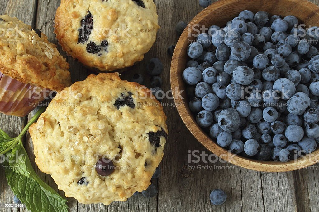 blueberry muffins and oatmeal stock photo