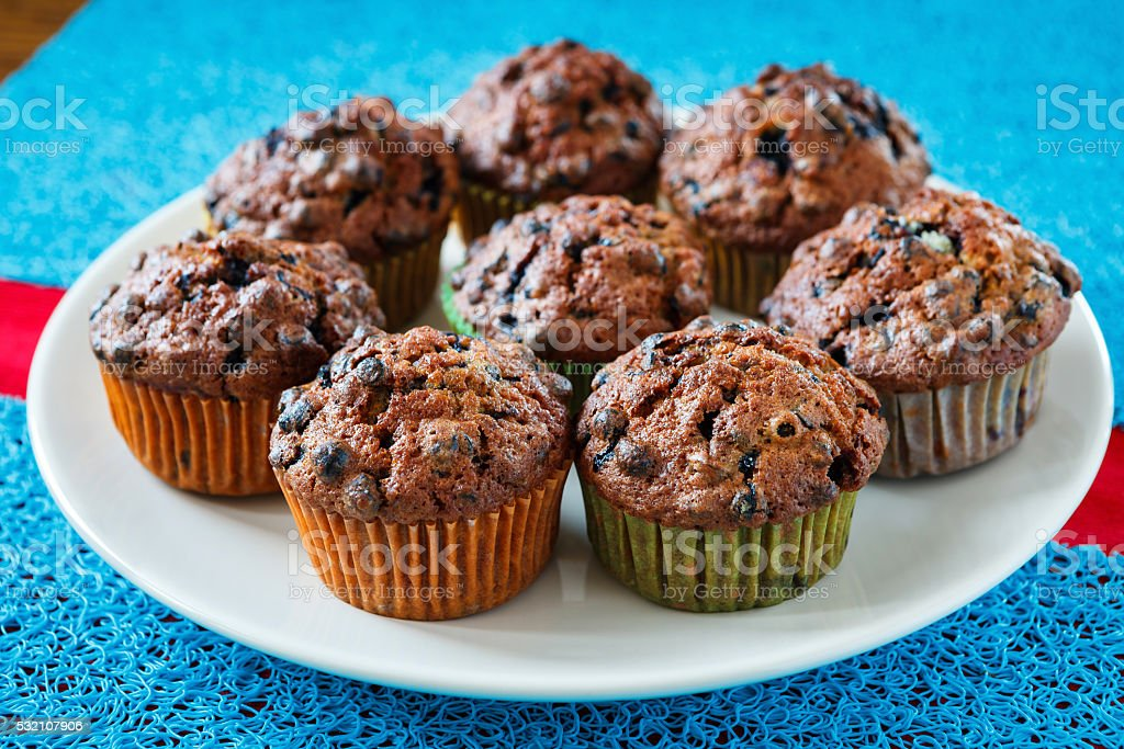 Blueberry muffins on plate stock photo