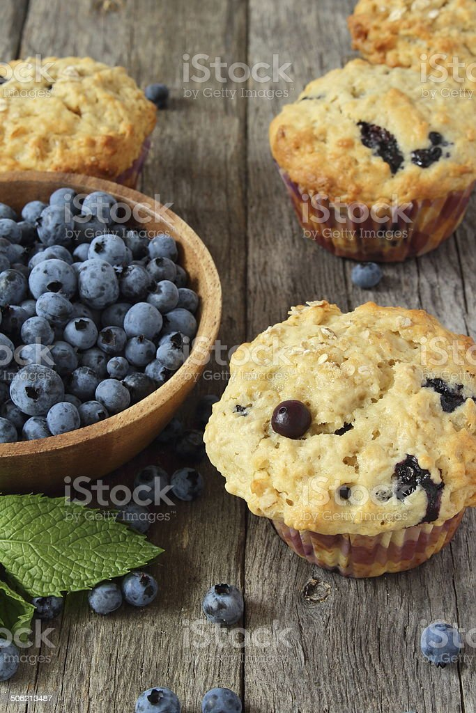 blueberry muffins on wooden board stock photo