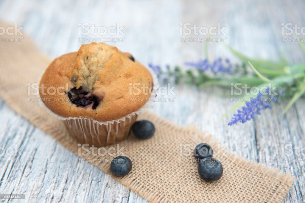 Blueberry muffins with blueberries on a wooden background stock photo