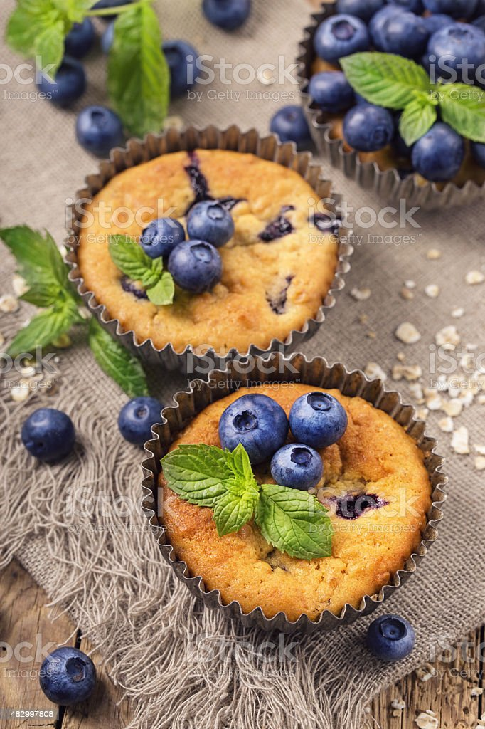 Blueberry muffins with oat flakes stock photo