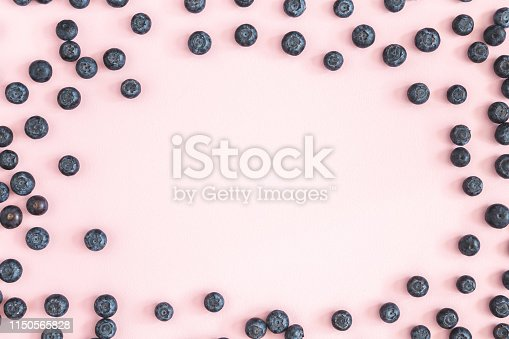 867774250 istock photo Blueberry on pink background. Flat lay, top view 1150565828