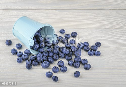 853493518 istock photo Blueberry on wooden background 684372918