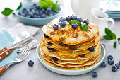istock Blueberry pancakes with butter, maple syrup and fresh berries. American breakfast 1260390270