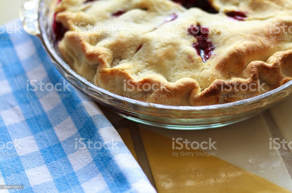 Blueberry Pie and Checked Dish Towel (Close-Up) stock photo