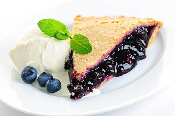 Blueberry pie slice stock photo