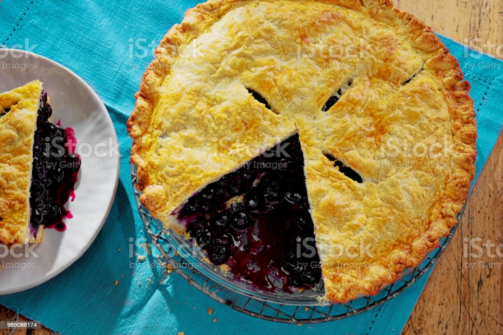 Blueberry pie sliced stock photo