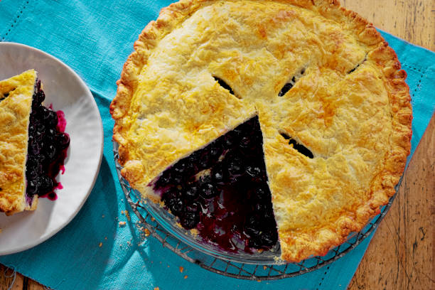 blueberry pie sliced - blueberry pie stock photos and pictures