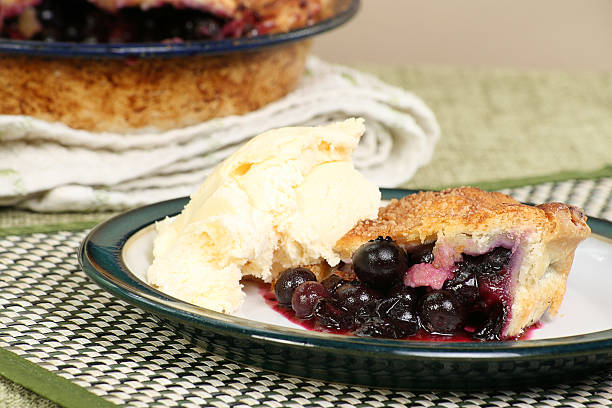 blueberry pie with ice cream stock photo