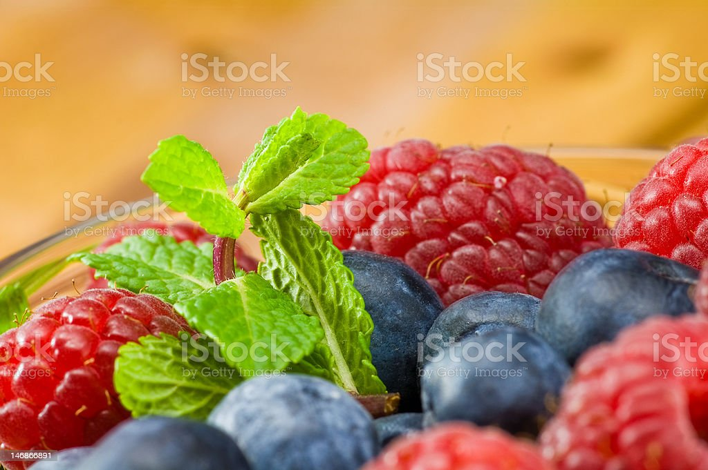 Blueberry, ruspberry and mint leaves royalty-free stock photo