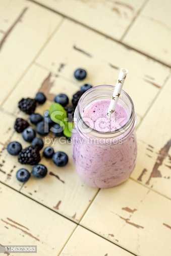 863562090 istock photo Blueberry smoothie in bottle 1156323083