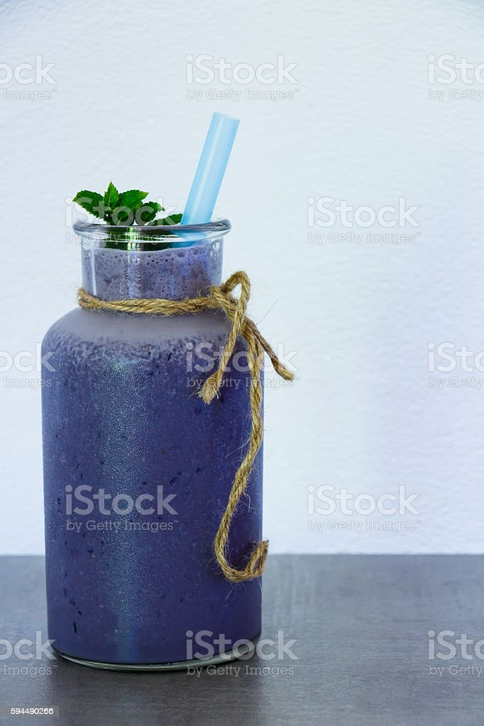 Blueberry smoothie in jar stock photo