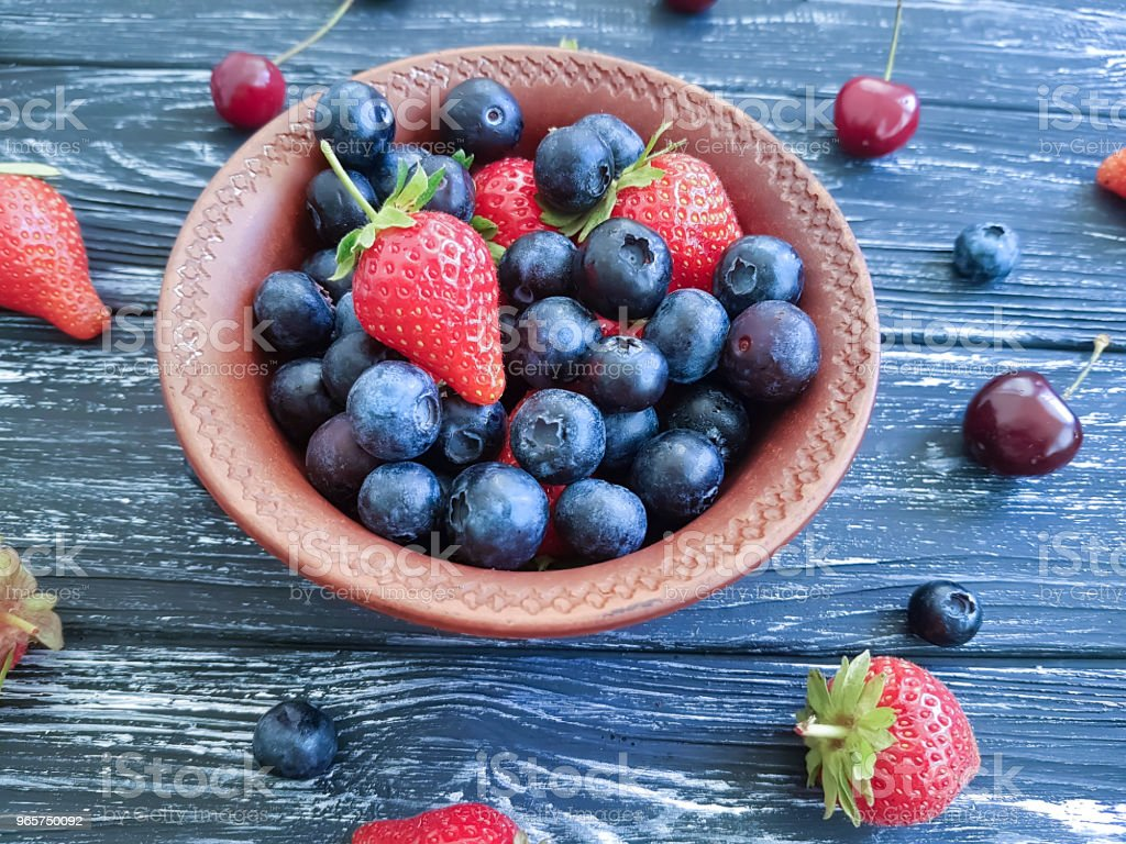 blueberry, strawberry cherry on old black wooden - Royalty-free Above Stock Photo