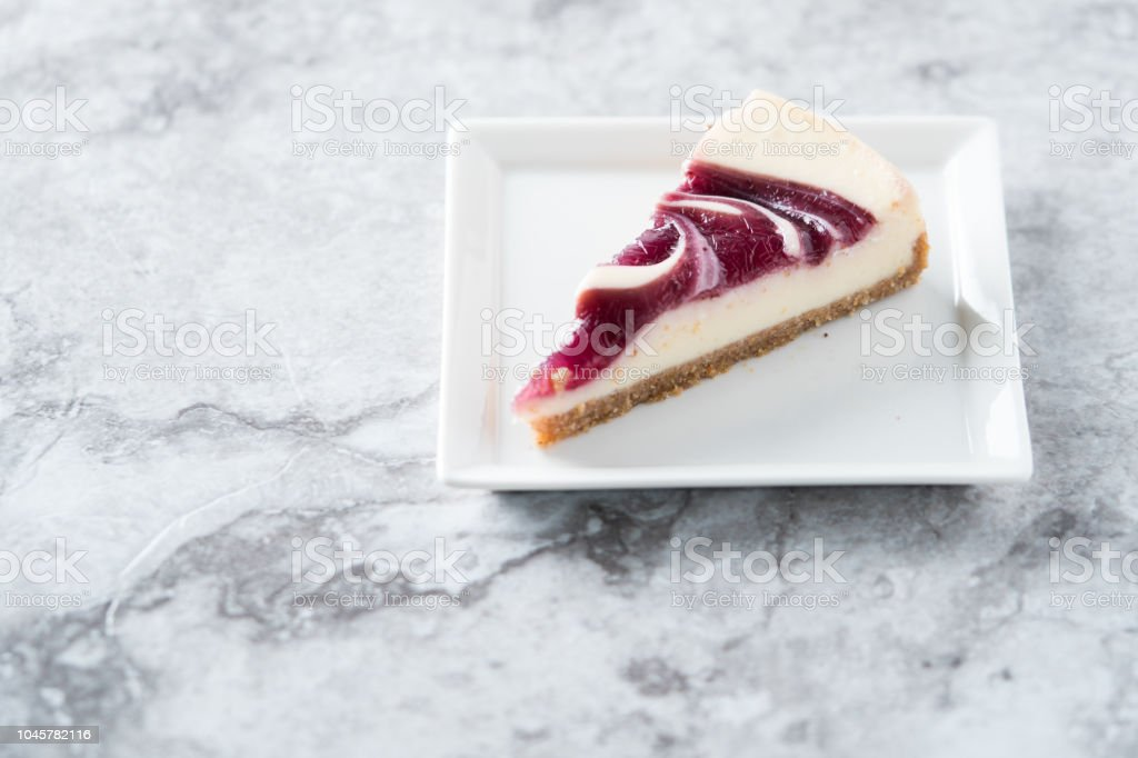 Blueberry swirl cheesecake slice stock photo