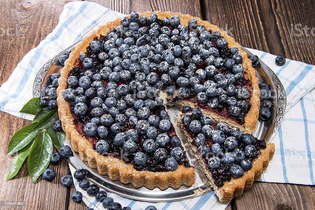 Blueberry tart with berries on top stock photo