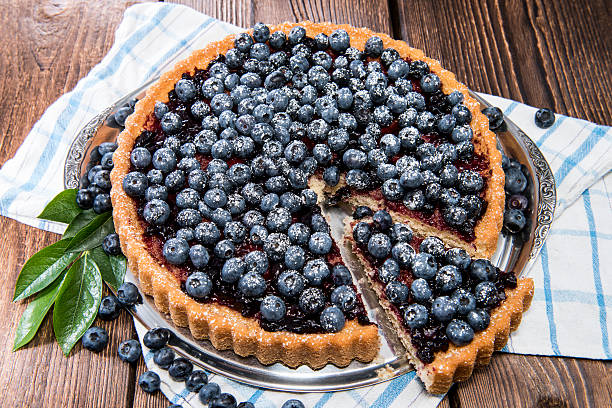 blueberry tart with berries on top - blueberry pie stock pictures, royalty-free photos & images