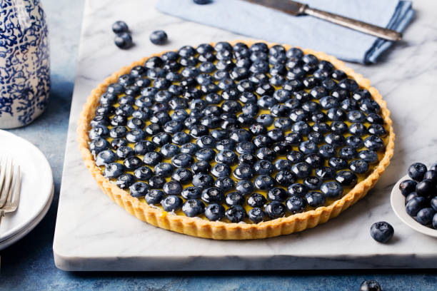blueberry tart with vanilla custard marble board - blueberry pie stock pictures, royalty-free photos & images