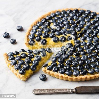 istock Blueberry tart with vanilla custard on a marble board. 619266892