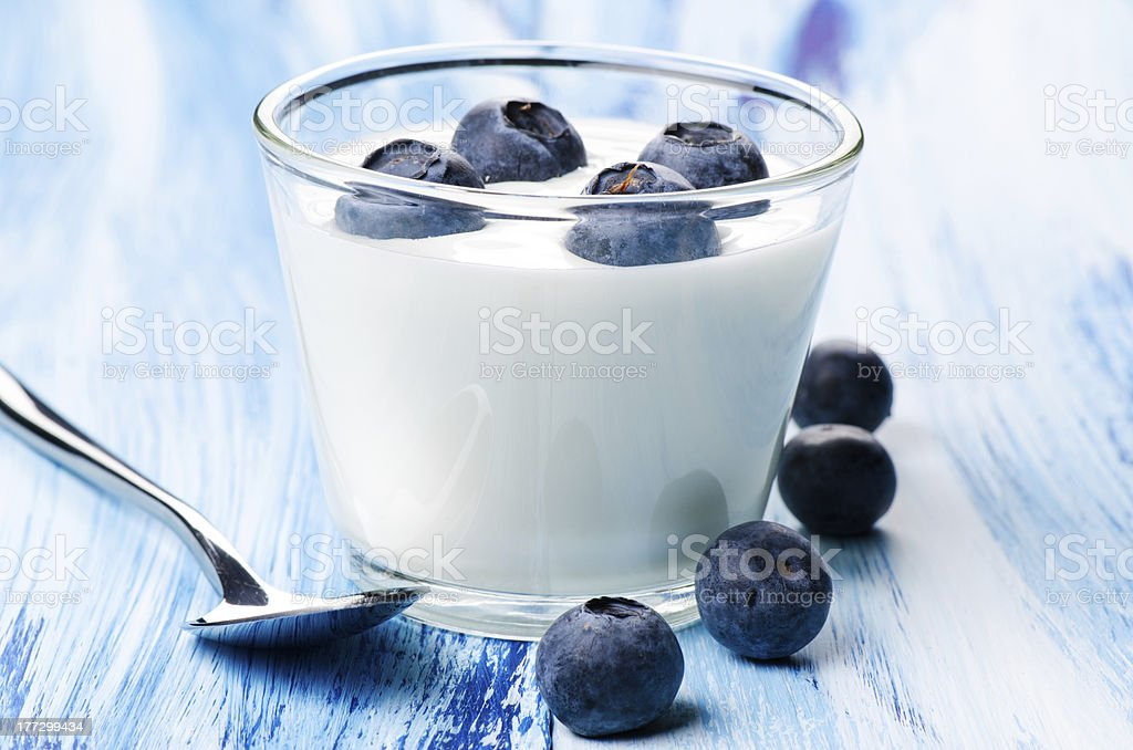 Blueberry yogurt in a glass Blueberry yogurt in a glass Berry Fruit Stock Photo