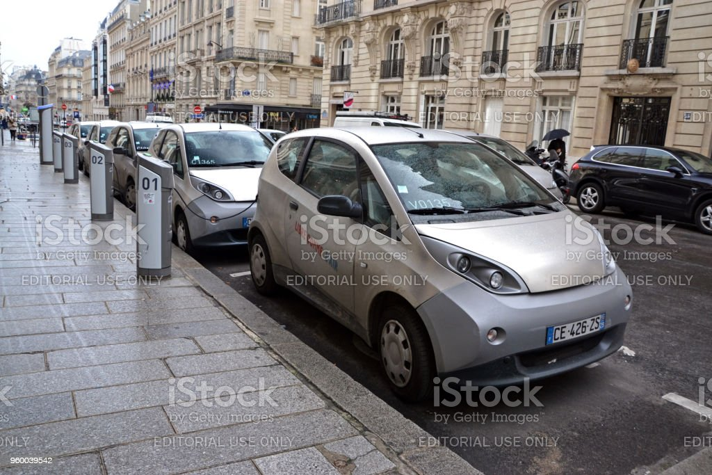 Bluecar vehicles on the parking and charging points stock photo