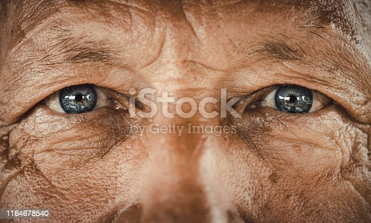 Close up of senior man's blue eyes looking at camera.