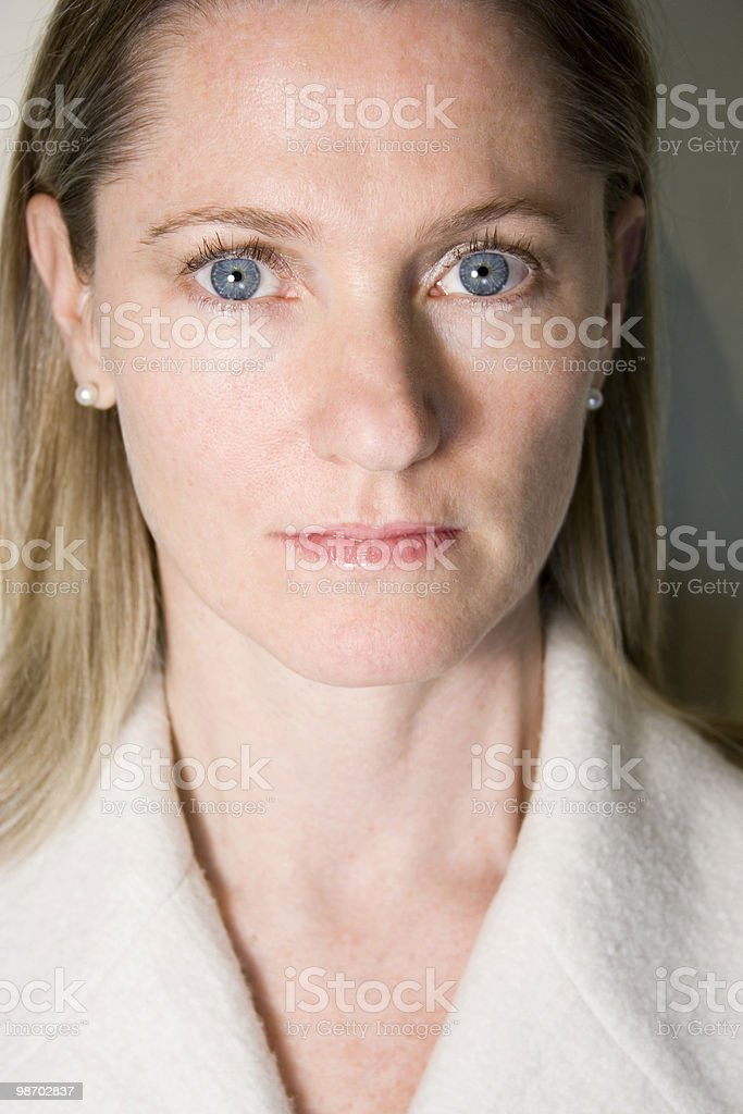 Blue-eyed, serious woman royalty-free stock photo
