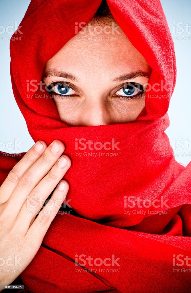 Blue-Eyed Woman Wrapped in Red Cloth royalty-free stock photo