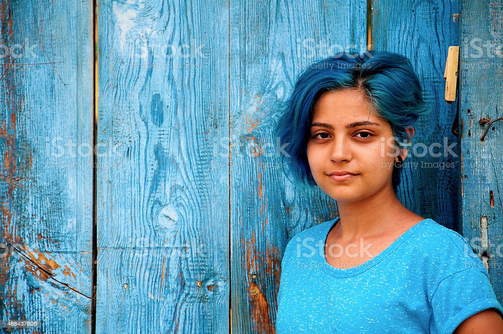 blue-haired young girl stock photo