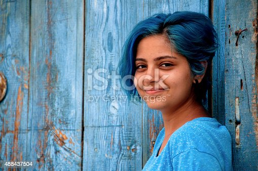istock blue-haired young girl smiles 488437504