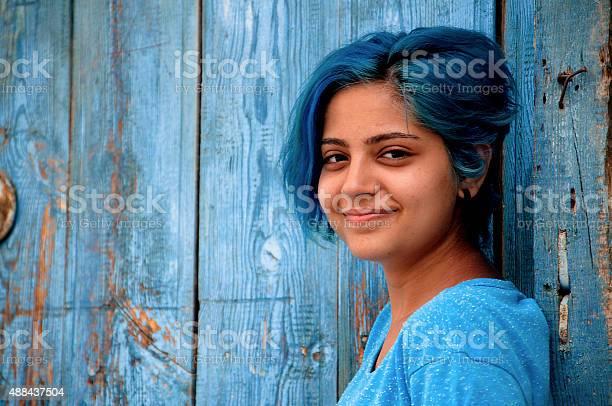 Bluehaired young girl smiles picture id488437504?b=1&k=6&m=488437504&s=612x612&h=nuwb9jeqqo6okrozuqdikhxmsjvvuvknltjhdziayam=