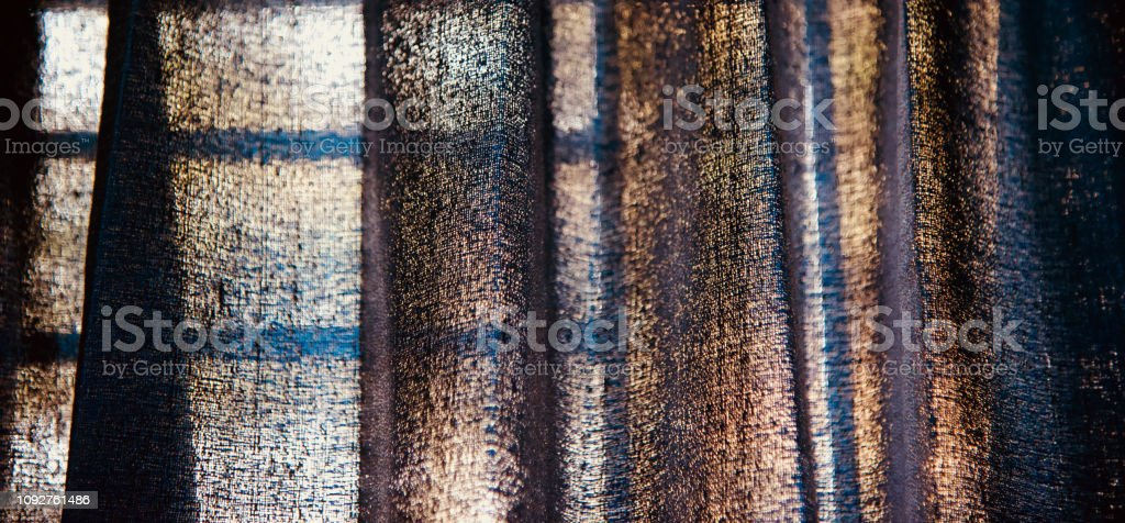 Blueish blurry curtain clothes of a window stock photo