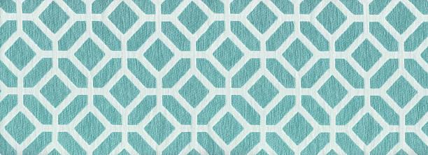 Blueish green diamond and octagon shape fabric pattern stock photo