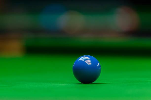Bluek snooker ball on green table background stock photo
