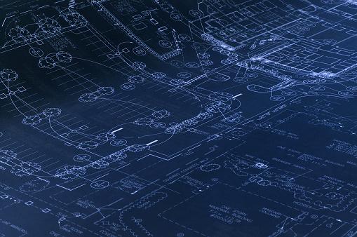 Landscape drawings on a dark blueprint.