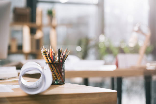 blueprint and pencils on table in modern architect office - selective focus stock pictures, royalty-free photos & images