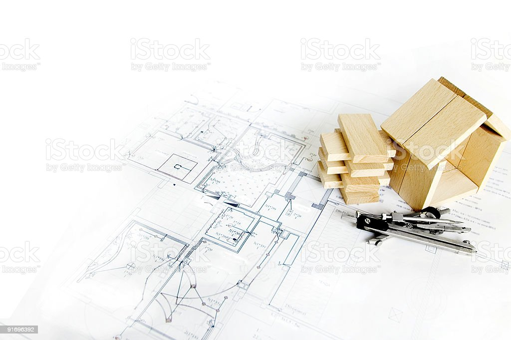 blueprint and wooden model of house royalty-free stock photo