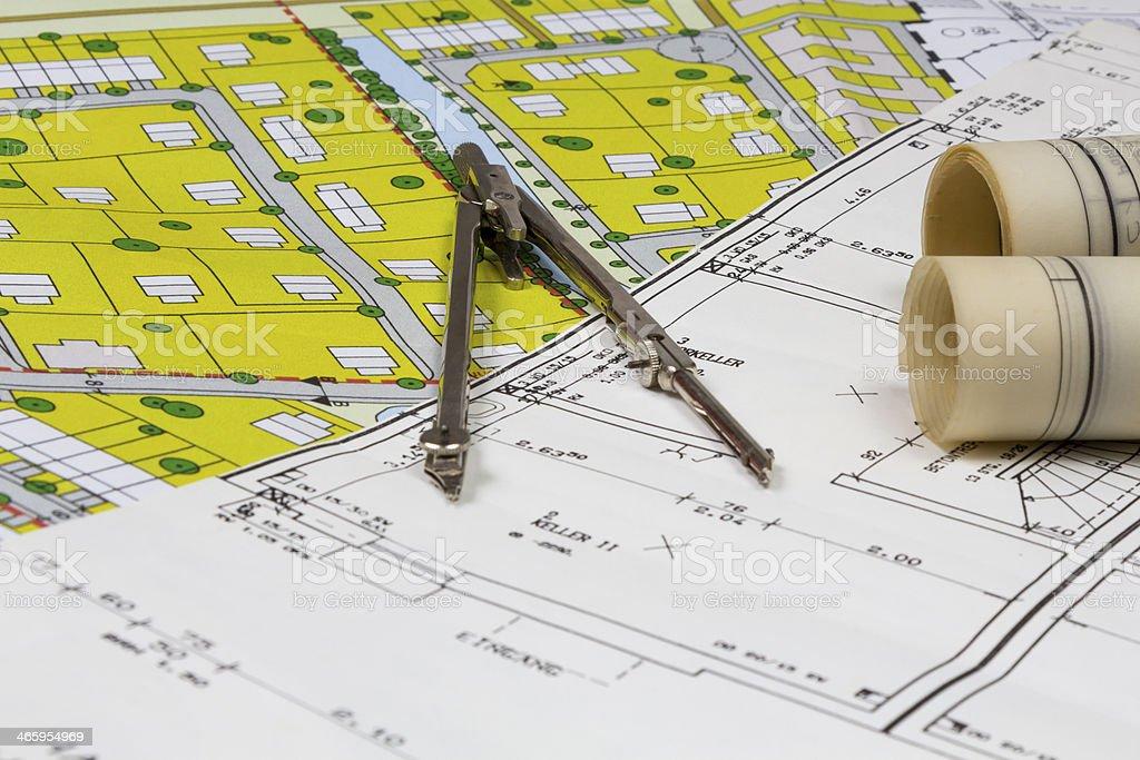 A blueprint of a design under a compass stock photo