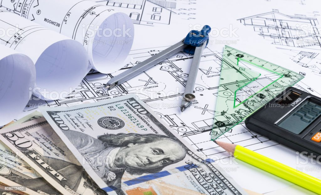 A blueprint of an architect with money calculator symbolic photo a blueprint of an architect with money calculator symbolic photo for financing and planning malvernweather Image collections