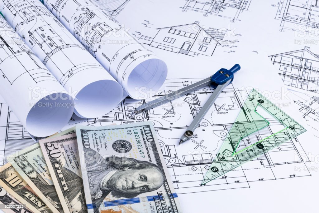 A blueprint of an architect with money symbolic photo for financing a blueprint of an architect with money symbolic photo for financing and planning of a malvernweather Gallery