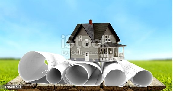 Architecture blueprints and house mock-up on sky background