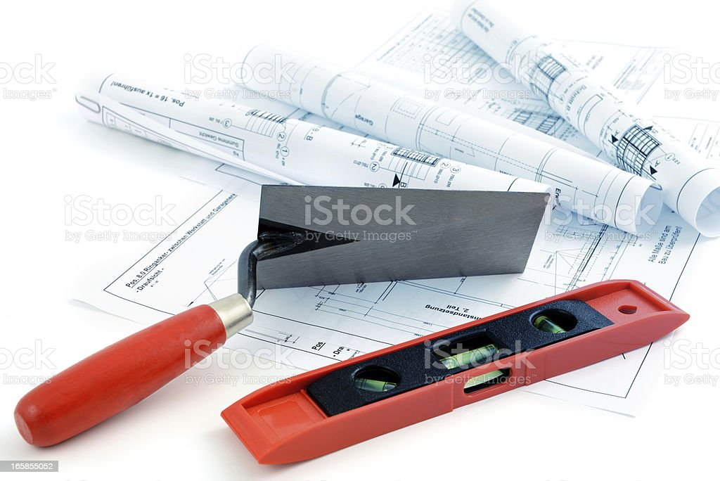 blueprint plan of house building with leven und trowel royalty-free stock photo