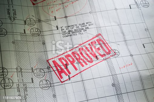 Blueprint with the word APPROVED stamped in red