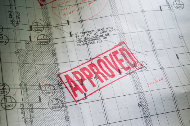 Blueprint with APPROVED rubber Stamped stock photo